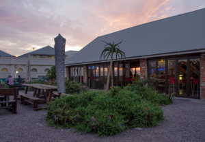 Catch a lovely sunset from The Globe - rooftop bar at Happy Hippo accommodation, ©David Peter Harris