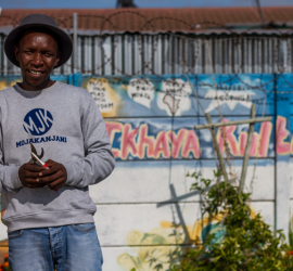 Xolisa Bangani, Head Farmer and Founder of Ikhaya Garden at Isikhokelo Primary School in Site C, Khayelitsha, Cape Town. ©David Peter Harris